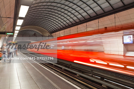 A train pulls out of a station on the Lyon metro system, Lyon, Rhone, Rhone-Alpes, France, Europe Stock Photo - Rights-Managed, Image code: 841-07355296