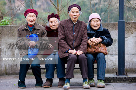 Elderly Chinese women sit together on a bench in Chongqing, China Stock Photo - Rights-Managed, Image code: 841-07457281