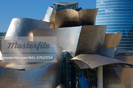 Architect Frank Gehry's Guggenheim Museum futuristic design in titanium and glass and Iberdrola Tower behind at Bilbao, Spain Stock Photo - Rights-Managed, Image code: 841-07523719