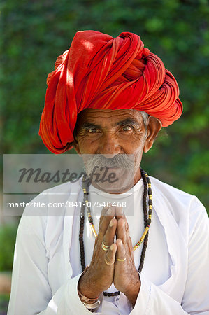 Traditional Namaste greeting from Indian man with traditional Rajasthani turban in village in Rajasthan, India Stock Photo - Rights-Managed, Image code: 841-07540468