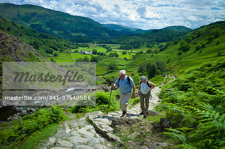 Tourists hill climbing on nature trail in lakeland countryside at Easedale in the Lake District National Park, Cumbria, UK Stock Photo - Rights-Managed, Image code: 841-07540506