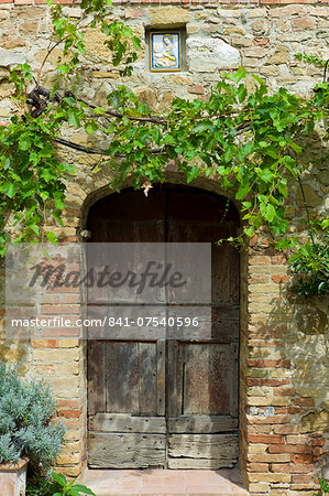 Ancient doorway and religious painting at Il Rigo agritourismo hotel and farmhouse, San Quirico d'Orcia, in Val D'Orcia area Tuscany, Italy Stock Photo - Rights-Managed, Image code: 841-07540596