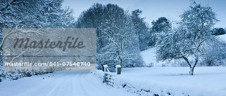 Traditional snow scene in a country lane in The Cotswolds, Swinbrook, Oxfordshire, United Kingdom Stock Photo - Rights-Managed, Image code: 841-07540740