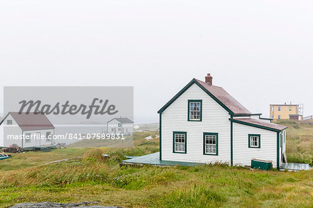 Fog rolls in over the small preserved fishing village of Battle Harbour, Labrador, Canada, North America Stock Photo - Rights-Managed, Image code: 841-07589831