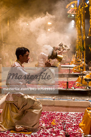 Hindu priests at sundown Aarti Ritual Ceremony of Light during Shivrati Festival in Holy City of Varanasi, Benares, India Stock Photo - Rights-Managed, Image code: 841-07589885