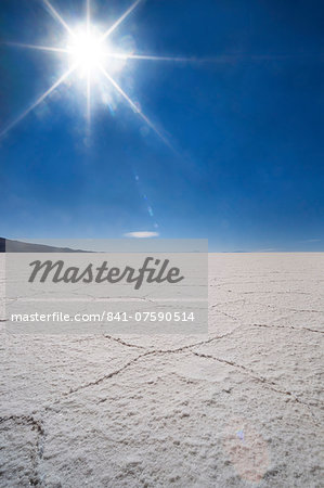 Backlit with sun star shot of hexagonal shaped salt flats, Salar de Uyuni, Bolivia, South America Stock Photo - Rights-Managed, Image code: 841-07590514