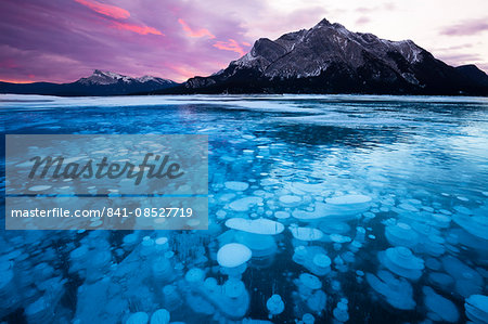 Bubbles and Cracks in the Ice with Mount Michener and Kista Peak in the Background at Sunrise, Abraham Lake, Alberta, Canada, North America Stock Photo - Rights-Managed, Image code: 841-08527719