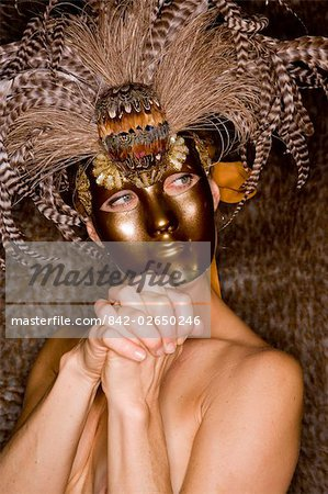 Portrait of young nude woman wearing masquerade mask, studio shot Stock Photo - Rights-Managed, Image code: 842-02650246