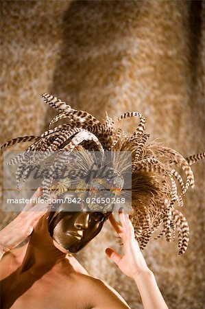 Portrait of young woman wearing masquerade mask, studio shot Stock Photo - Rights-Managed, Image code: 842-02650268