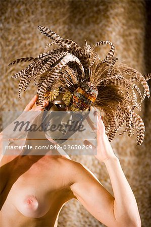 Portrait of young woman wearing masquerade mask, studio shot Stock Photo - Rights-Managed, Image code: 842-02650269