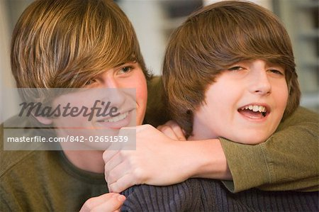 Portrait of brothers sitting together on porch Stock Photo - Rights-Managed, Image code: 842-02651539