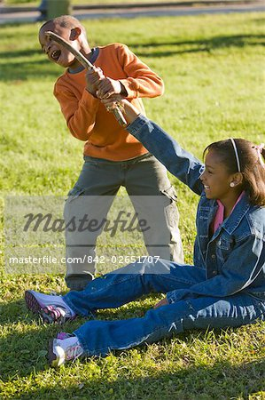 Portrait of African American boy and girl playing outdoors in park Stock Photo - Rights-Managed, Image code: 842-02651707