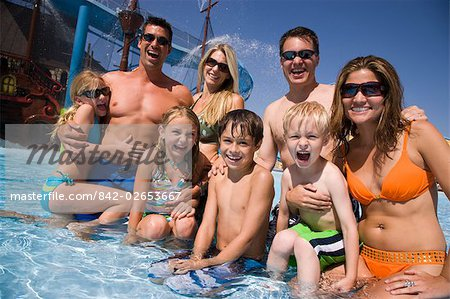 Portrait of family and friends having fun at water park Stock Photo - Rights-Managed, Image code: 842-02653667