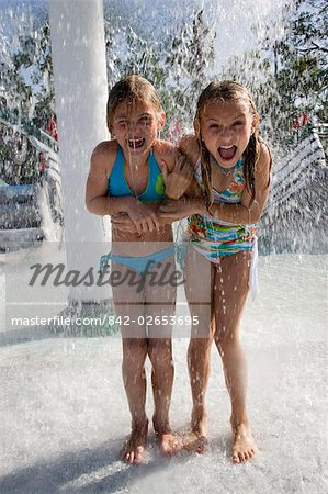 Girls dancing in splashing water at water park Stock Photo - Rights-Managed, Image code: 842-02653695