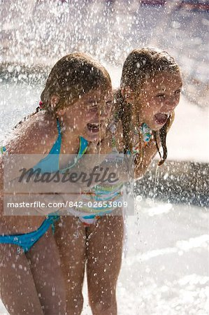 Girls shouting in splashing water at water park Stock Photo - Rights-Managed, Image code: 842-02653809