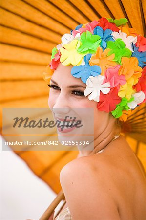 Portrait of young woman wearing retro swimming cap holding parasol Stock Photo - Rights-Managed, Image code: 842-02655304