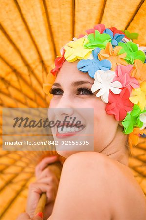 Portrait of young woman wearing retro swimming cap holding parasol Stock Photo - Rights-Managed, Image code: 842-02655305