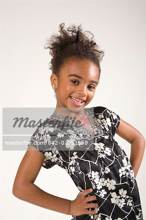 Portrait of young stylish African American girl, studio shot Stock Photo - Rights-Managed, Image code: 842-02751559