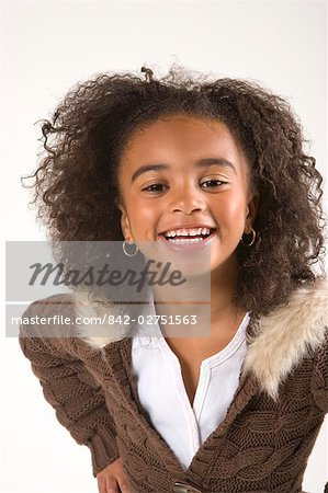 Portrait of young stylish African American girl, studio shot Stock Photo - Rights-Managed, Image code: 842-02751563