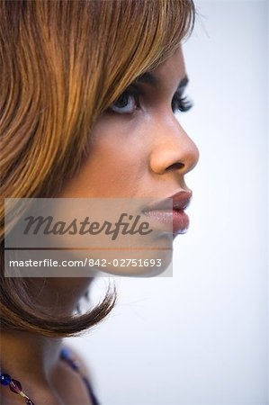 ... Photo - Side view of young stylish African American woman, studio shot