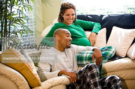 Portrait of African American couple sitting on sofa in living room Stock Photo - Rights-Managed, Image code: 842-02753795