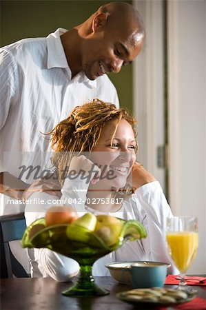 African American man massaging woman's shoulders Stock Photo - Rights-Managed, Image code: 842-02753817