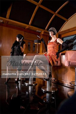Portrait of women in flapper dress sitting at bar with cigarette in the 1920s Stock Photo - Rights-Managed, Image code: 842-02754533