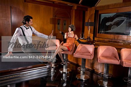 Portrait of 1920s socialite couple at billiards table 1920s bar Stock Photo - Rights-Managed, Image code: 842-02754541