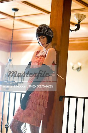 Portrait of woman in flapper dress sitting at bar with cigarette in the 1920s Stock Photo - Rights-Managed, Image code: 842-02754625