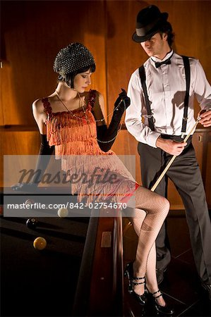 Portrait of 1920s socialite couple at billiards table 1920s bar Stock Photo - Rights-Managed, Image code: 842-02754670