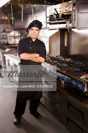 Portrait of Cuban chef standing in restaurant kitchen Stock Photo - Rights-Managed, Image code: 842-03198515