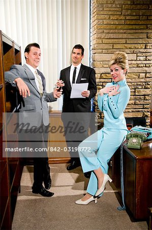 Vintage portrait of young secretary with beehive and two businessmen in office Stock Photo - Rights-Managed, Image code: 842-03198772