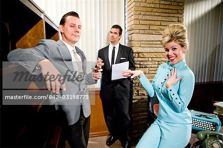 Vintage portrait of young secretary with beehive and two businessmen in office Stock Photo - Rights-Managed, Image code: 842-03198773