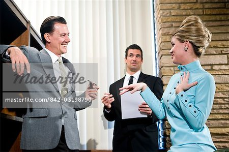 Vintage portrait of young secretary with beehive and two businessmen in office Stock Photo - Rights-Managed, Image code: 842-03198790