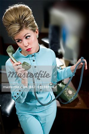 Vintage portrait of young secretary with beehive answering the phone Stock Photo - Rights-Managed, Image code: 842-03198804