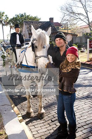 Portrait of young couple standing with horse drawn carriage Stock Photo - Rights-Managed, Image code: 842-03198848