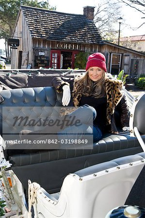 Young woman in warm clothes sitting in horse drawn carriage Stock Photo - Rights-Managed, Image code: 842-03198849