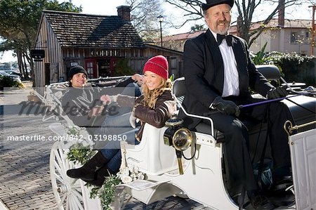 Young couple riding in horse-drawn carriage Stock Photo - Rights-Managed, Image code: 842-03198850