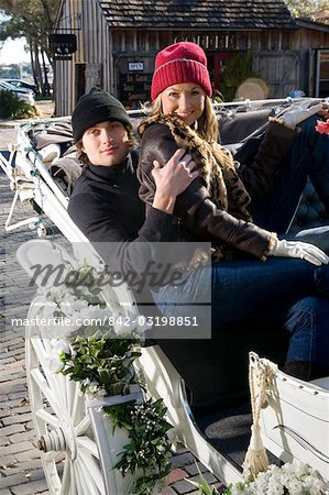 Young couple riding in horse-drawn carriage Stock Photo - Rights-Managed, Image code: 842-03198851
