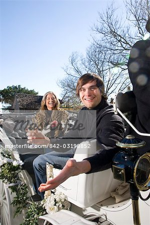 Young couple riding in horse-drawn carriage Stock Photo - Rights-Managed, Image code: 842-03198852
