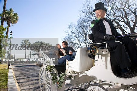 Young couple riding in horse-drawn carriage Stock Photo - Rights-Managed, Image code: 842-03198853