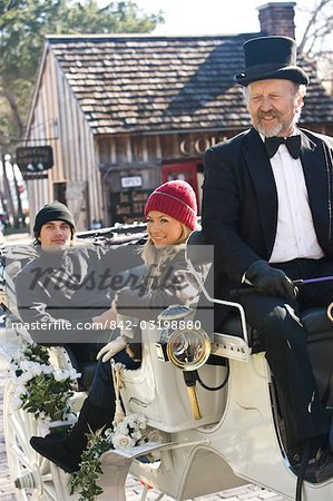 Young couple in warm clothing sitting in horse-drawn carriage Stock Photo - Rights-Managed, Image code: 842-03198880