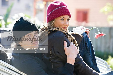 Young couple in warm clothing sitting in horse-drawn carriage Stock Photo - Rights-Managed, Image code: 842-03198881