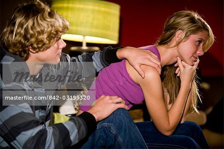Thoughtful young teenage couple sitting on sofa indoors Stock Photo - Rights-Managed, Image code: 842-03199320