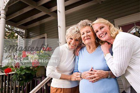 Elderly woman with adult daughters outside house Stock Photo - Rights-Managed, Image code: 842-03200062