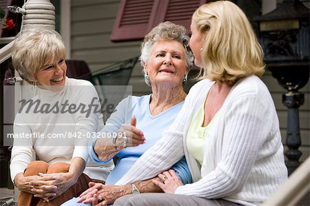 Elderly woman and adult daughters on front porch of house Stock Photo - Rights-Managed, Image code: 842-03200091