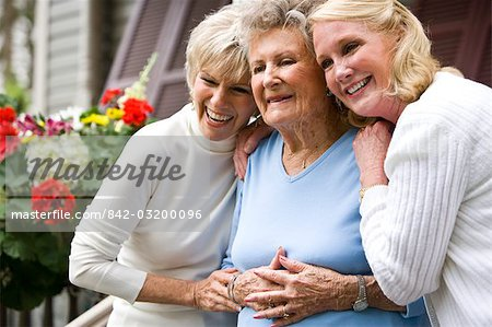 Elderly woman and adult daughters on front porch of house Stock Photo - Rights-Managed, Image code: 842-03200096