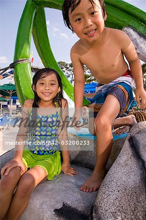 Two Asian children on at water park in summer Stock Photo - Rights-Managed, Image code: 842-03200233