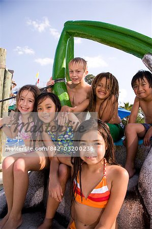Multi-ethnic children at water park in summer Stock Photo - Rights-Managed, Image code: 842-03200236