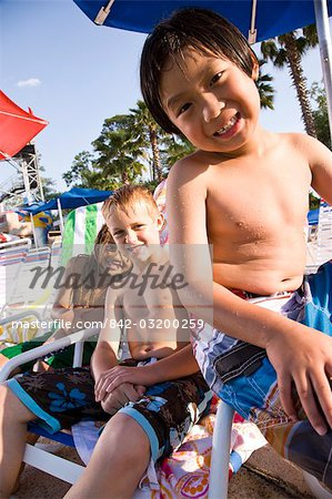Multi-ethnic boys at water park in summer Stock Photo - Rights-Managed, Image code: 842-03200259